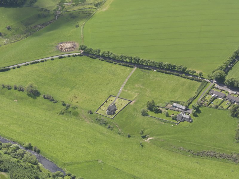Oblique aerial view of Cranshaws Parish Church, taken from the NE.