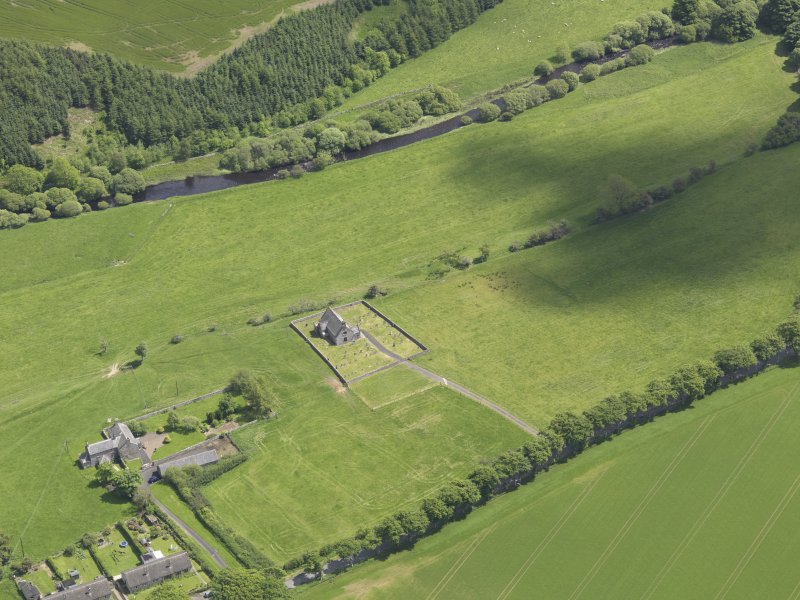 Oblique aerial view of Cranshaws Parish Church, taken from the WNW.