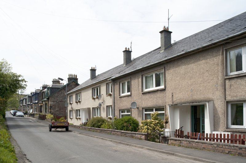 General view from SE showing 1950s local authority housing block at 1-8 Bannatyne Mains Road, Port Bannatyne, Bute