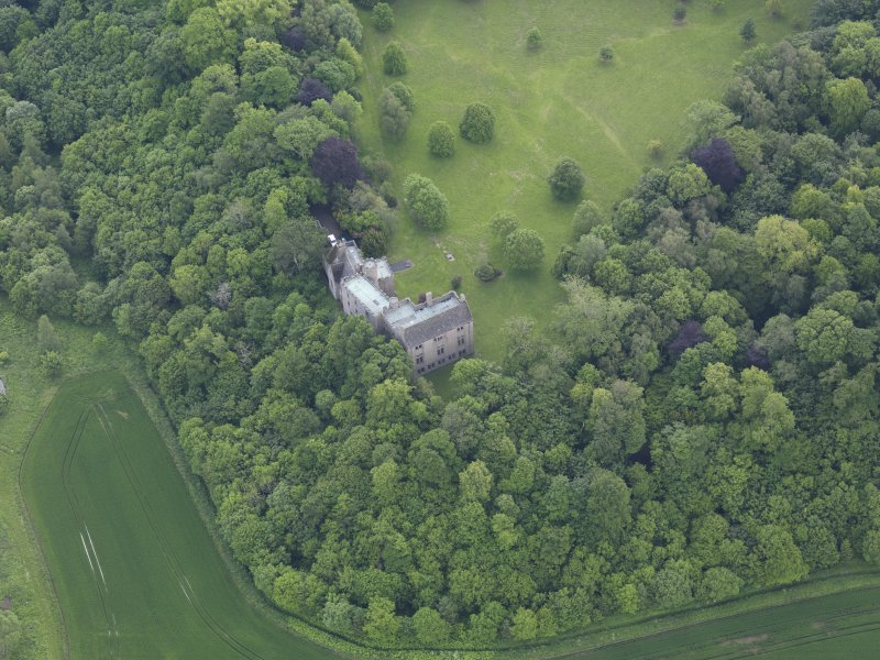 Oblique aerial view of Hutton Castle, taken from the NNW.