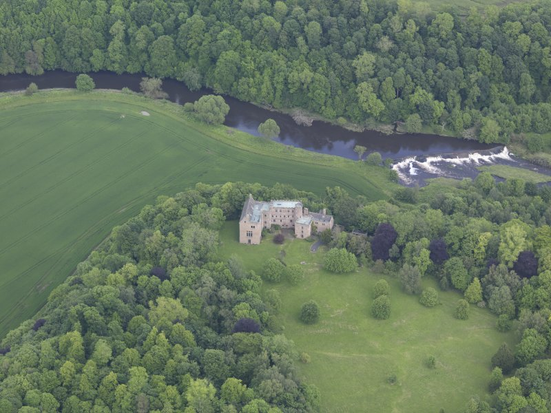 Oblique aerial view of Hutton Castle, taken from the SSW.