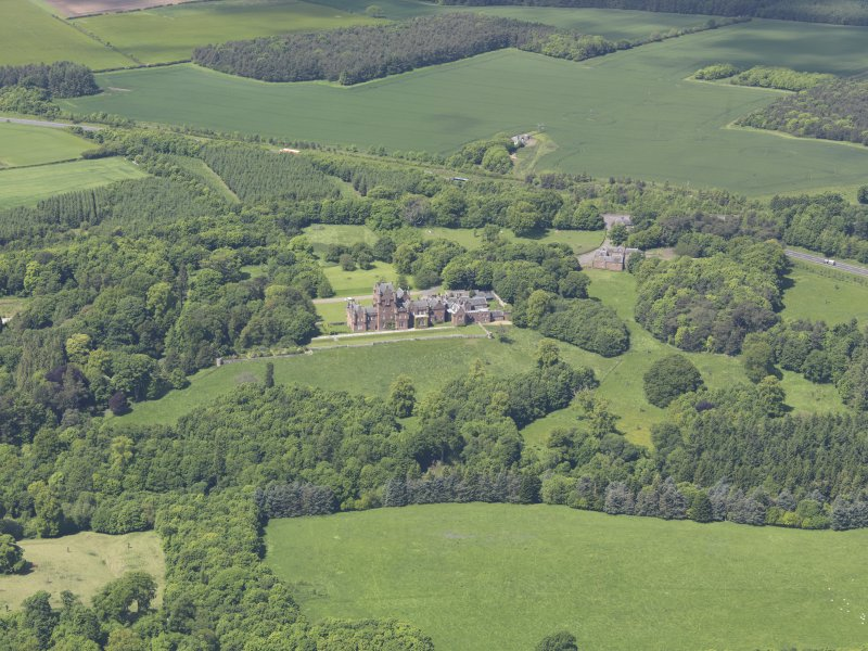General oblique aerial view of Ayton Castle, taken from the SSW.
