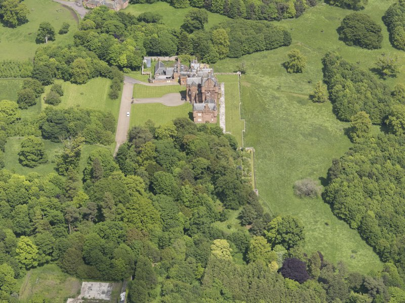 Oblique aerial view of Ayton Castle, taken from the SW.