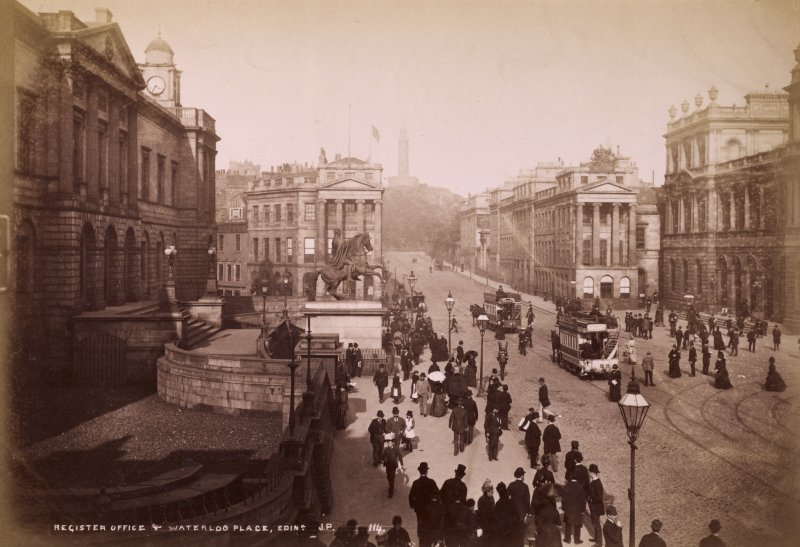 General view of Waterloo Place, Edinburgh from west with trams. Titled: 'Register Office & Waterloo Place with trams 114 JP' PHOTOGRAPH ALBUM No.195: PHOTOGRAPHS BY G.W.WILSON & Co. p.47 Photograph Album 195  Photographs by G W Wilson & Co