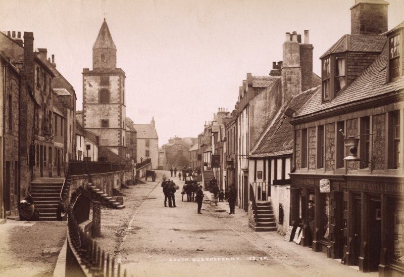 South Queensferry. View of High Street with figures and shops. Titled: 'South Queensferry. 153. J.P'. PHOTOGRAPH ALBUM No 195: PHOTOGRAPHS BY G W WILSON & CO. p.95.