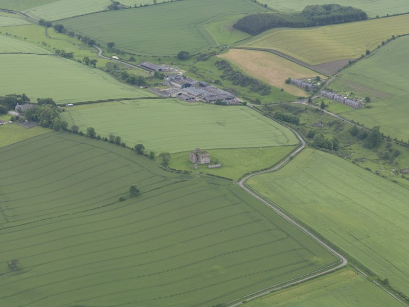 General oblique aerial view of Cessford Castle, taken from the ENE.