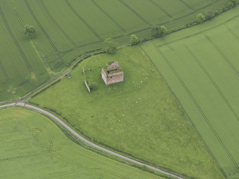 Oblique aerial view of Cessford Castle, taken from the NW.