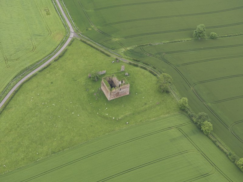 Oblique aerial view of Cessford Castle, taken from the SW.
