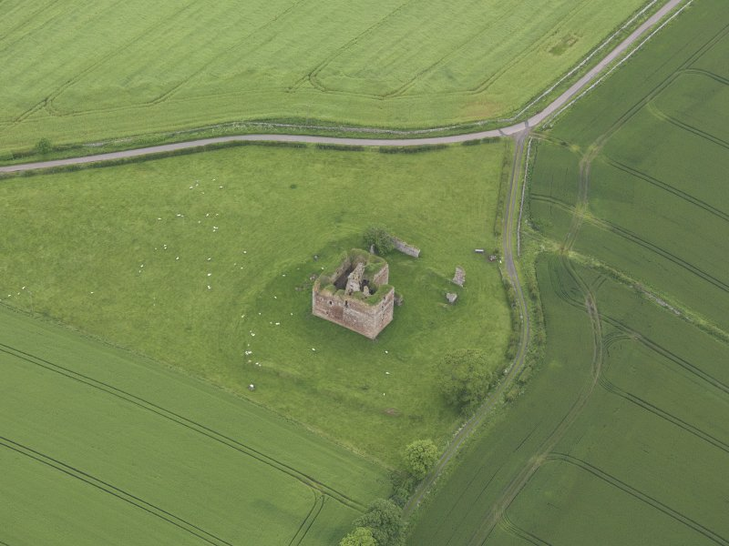 Oblique aerial view of Cessford Castle, taken from the SE.