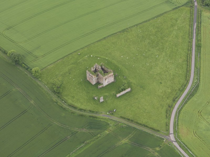 Oblique aerial view of Cessford Castle, taken from the NE.