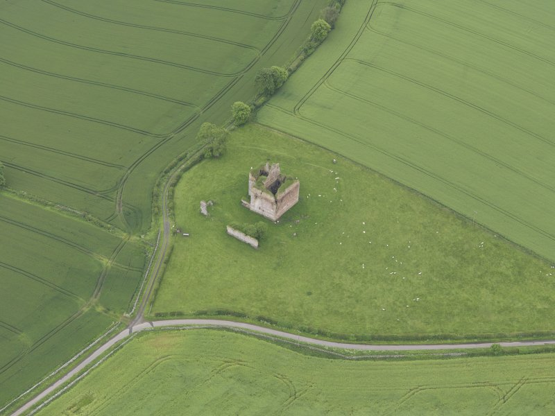 Oblique aerial view of Cessford Castle, taken from the NNW.