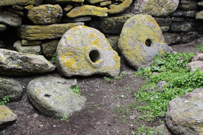 General view of quern stones now sitting within the chapel interior.