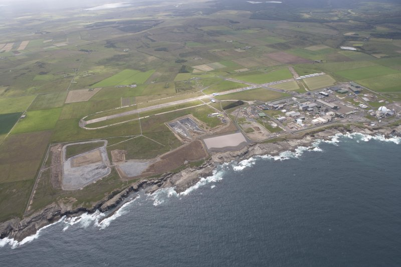 General oblique view of Dounreay Nuclear Power Development Establishment, and the disused airfield, looking to the SE.
