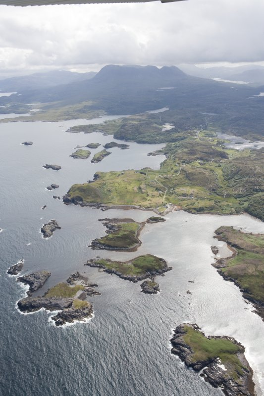 General oblique aerial view across Drumbeg towards Quinag, looking ESE.