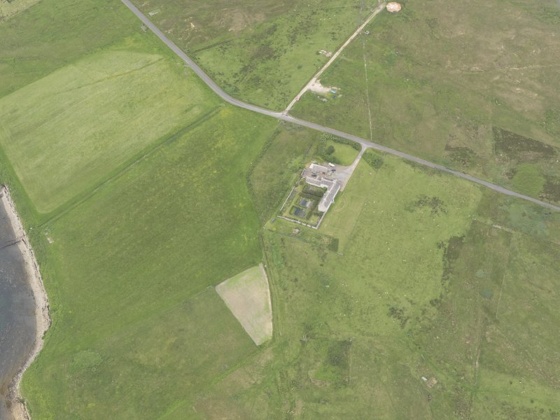 Oblique aerial view centred on Rysa Lodge, Hoy, looking SW.