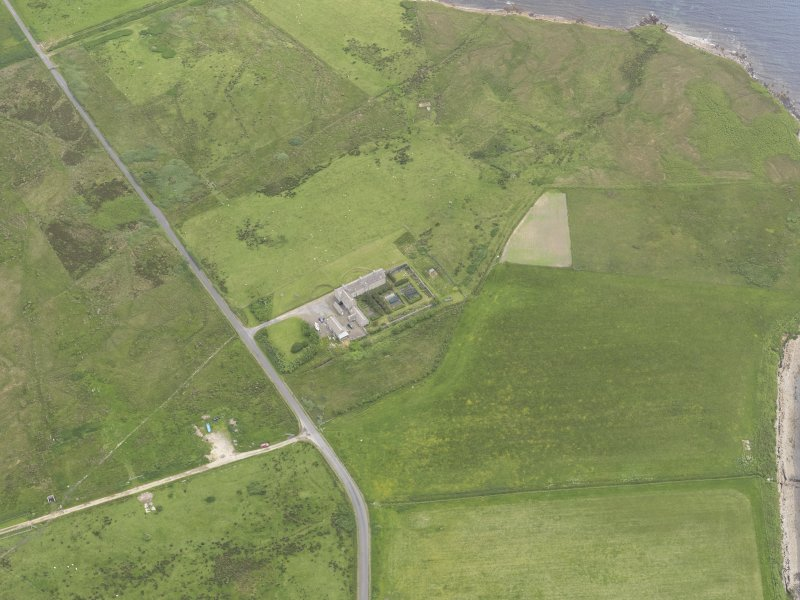 Oblique aerial view centred on Rysa Lodge, Hoy, looking NE.
