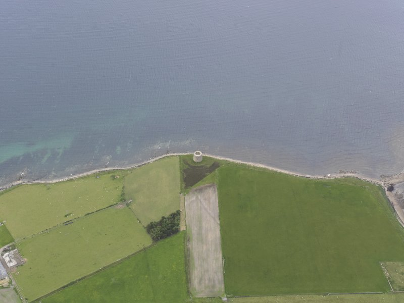 Oblique aerial view centred on the Crockness Martello Tower, looking E.