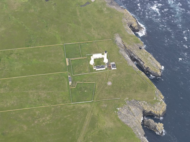 Oblique view of Muckle Skerry, centred on the lighthouse, looking to the W.