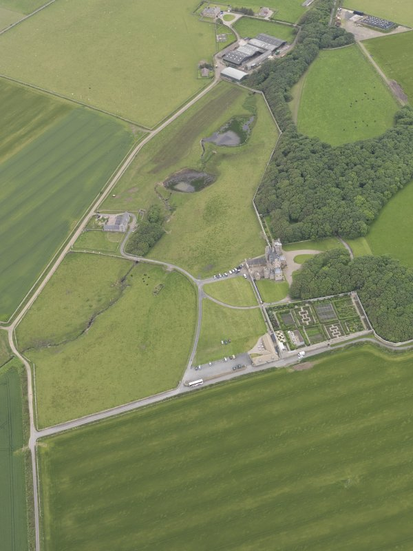 Oblique aerial view centred on Castle of Mey, looking ESE.