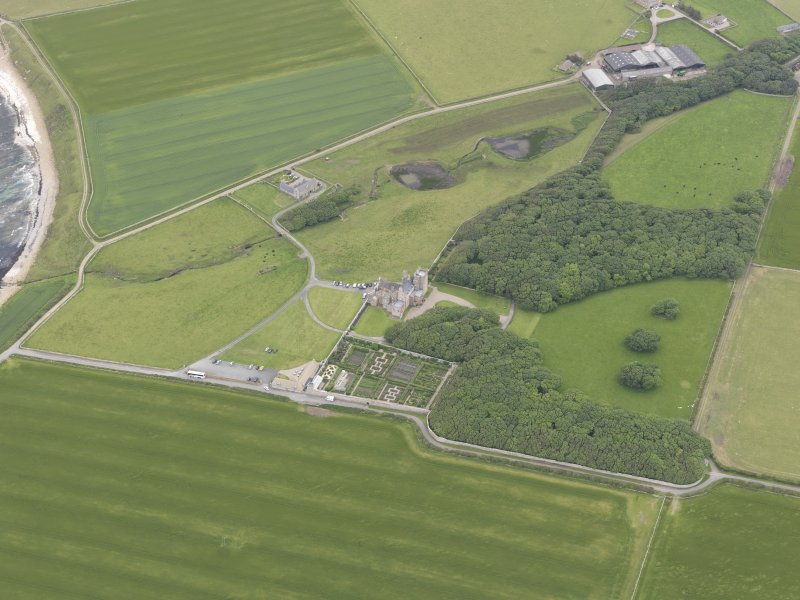 Oblique aerial view centred on Castle of Mey, looking ENE.