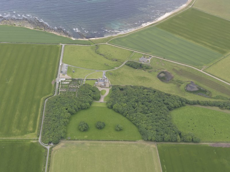 Oblique aerial view centred on Castle of Mey, looking N.