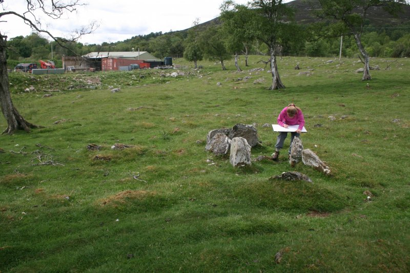 View from E of central chamber. Mrs A Gannon checking the plane table survey plan.