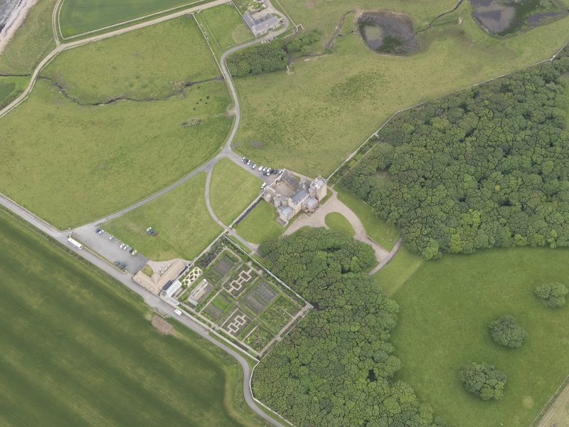 Oblique aerial view centred on Castle of Mey, looking NE.