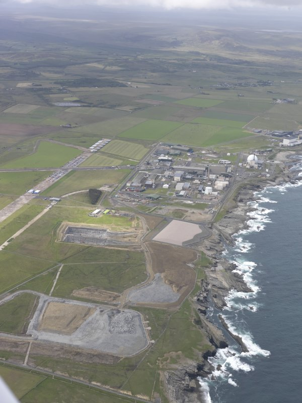 General oblique aerial view of Dounreay Nuclear Development Establishment, looking W.