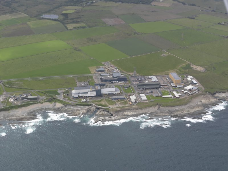 Oblique aerial view of Dounreay Nuclear Development Establishment, centred on the SW site, looking SE.