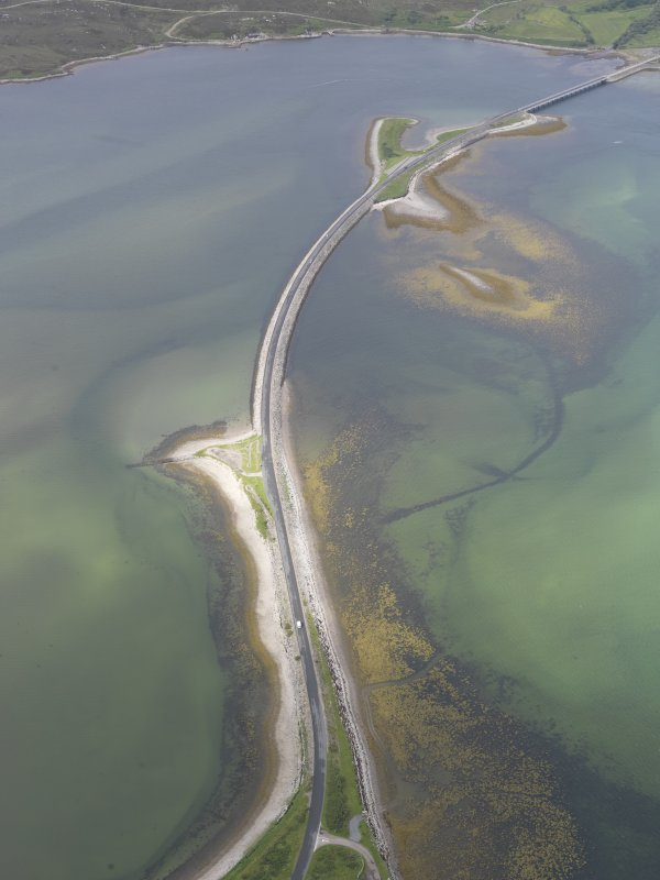 Oblique aerial view of the A836 causeway crossing the Kyle of Tonge, with the earlier causeway adjacent, looking W.