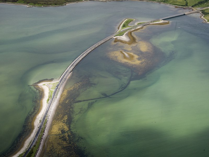 Oblique aerial view of the A836 causeway crossing the Kyle of Tonge, with the earlier causeway adjacent, looking WSW.