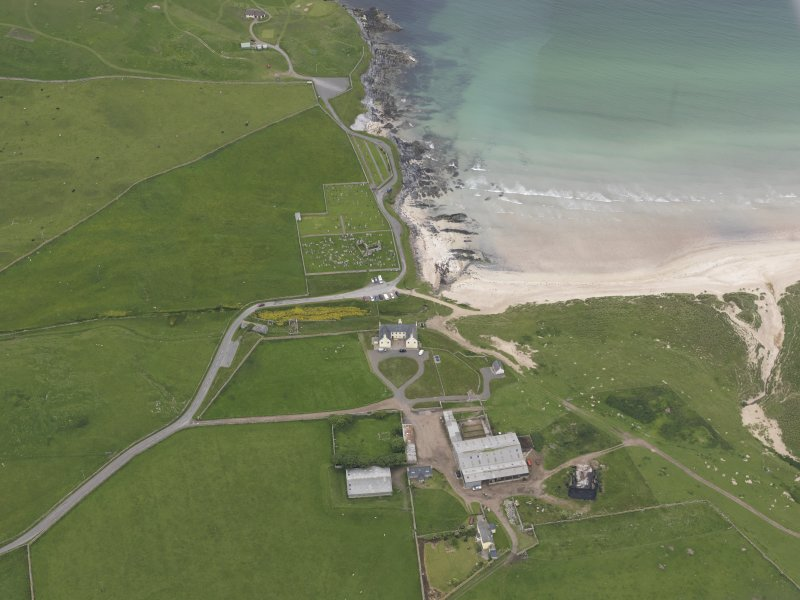 Oblique aerial view centred on Balnakeil House and Durness Parish Church, looking NW.