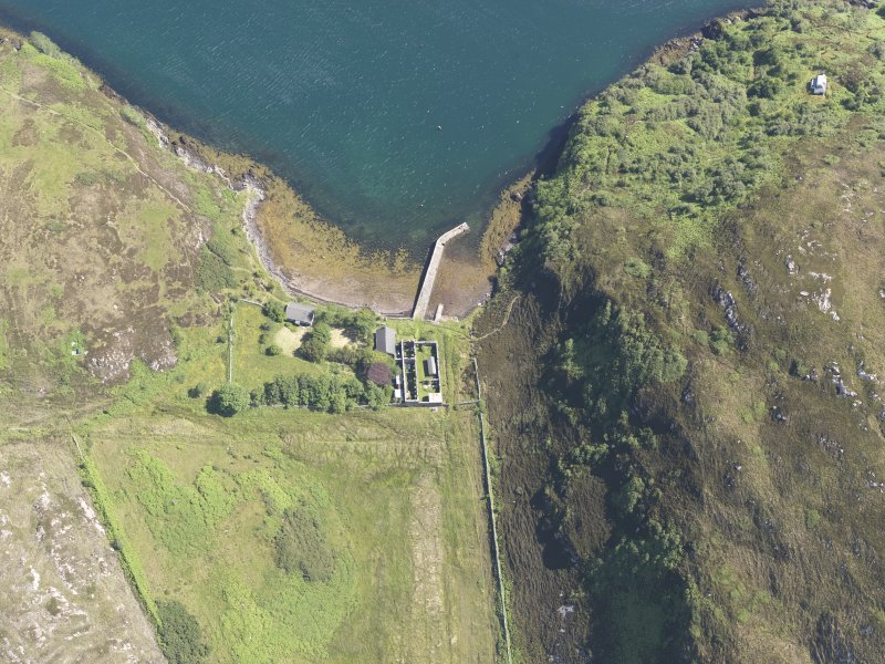 Oblique aerial view of the pier and buildings, Tanera Mor/Tannara Mor, looking E.