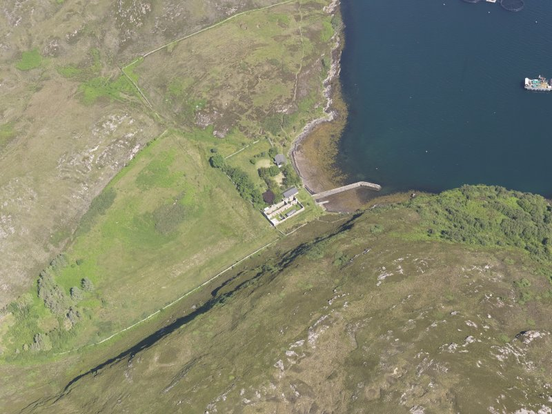 Oblique aerial view of the pier and buildings, Tanera Mor/Tannara Mor, looking N.