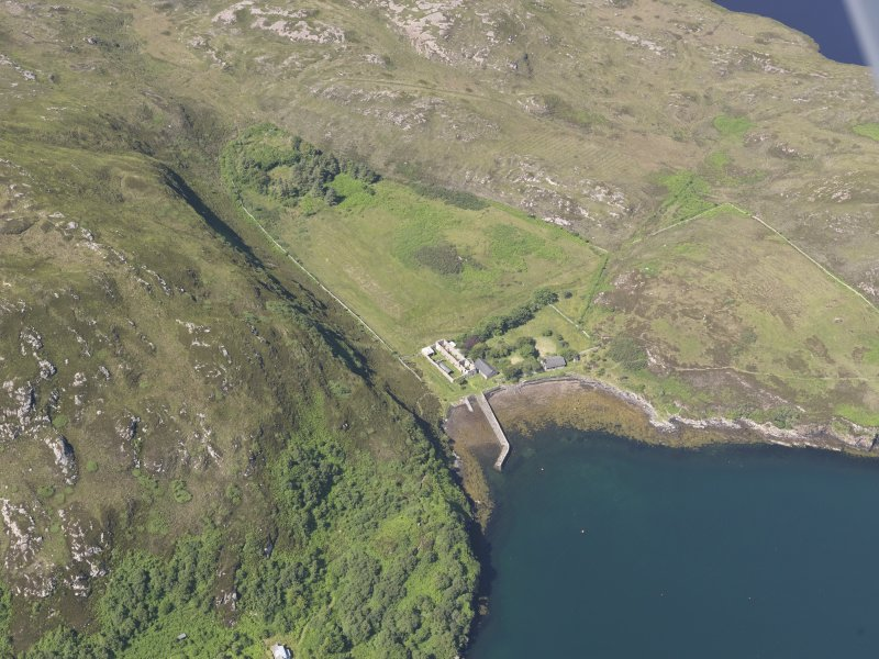 Oblique aerial view of the pier and buildings, Tanera Mor/Tannara Mor, looking W.