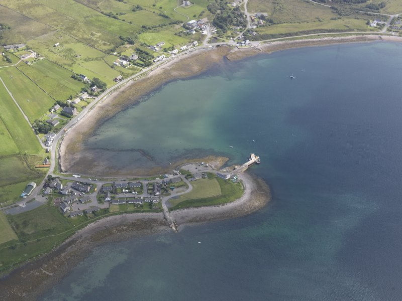 Oblique aerial view of Aultbea, centred on the pier, looking E.