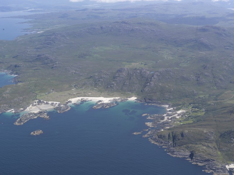 Oblique aerial view of Sanna, Portuairk and the Ardnamurchan volcano, looking E.
