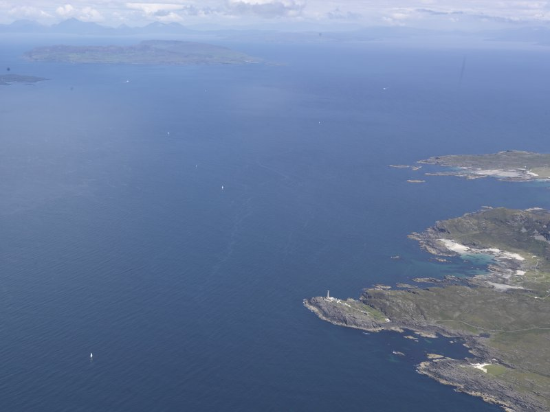 Oblique aerial view of Ardnamurchan lighthouse with Eigg beyond, looking N.