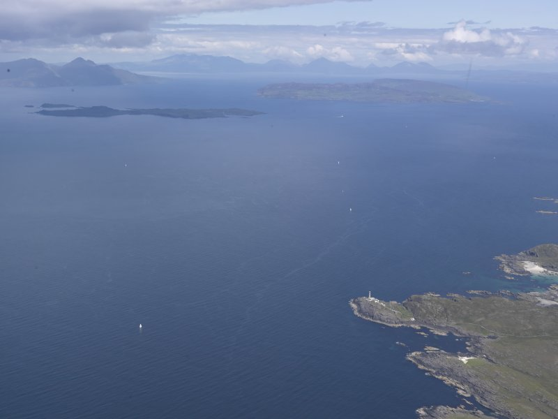 Oblique aerial view of Ardnamurchan lighthouse with Eigg, Muck and Rum beyond, looking N.