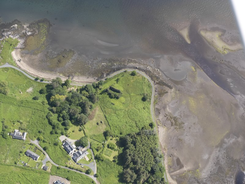 Oblique aerial view centred on Aros Castle, looking E.