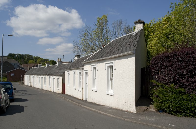 General view from SE showing whitewashed cotton workers' cottages at 1, 2, 3, 4 and 5 John Street, Rothesay, Bute