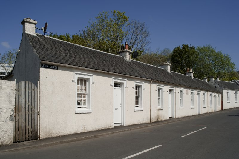 General view from W showing whitewashed cotton workers' cottages at 1, 2, 3, 4 and 5 John Street, Rothesay, Bute