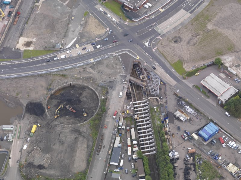 Oblique aerial view of Dalmarnock Station during construction works, taken from the S.