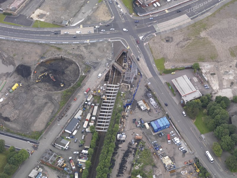 Oblique aerial view of Dalmarnock Station during construction works, taken from the SSE.