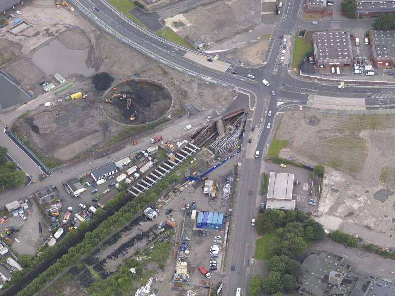 Oblique aerial view of Dalmarnock Station during construction works, taken from the SE.