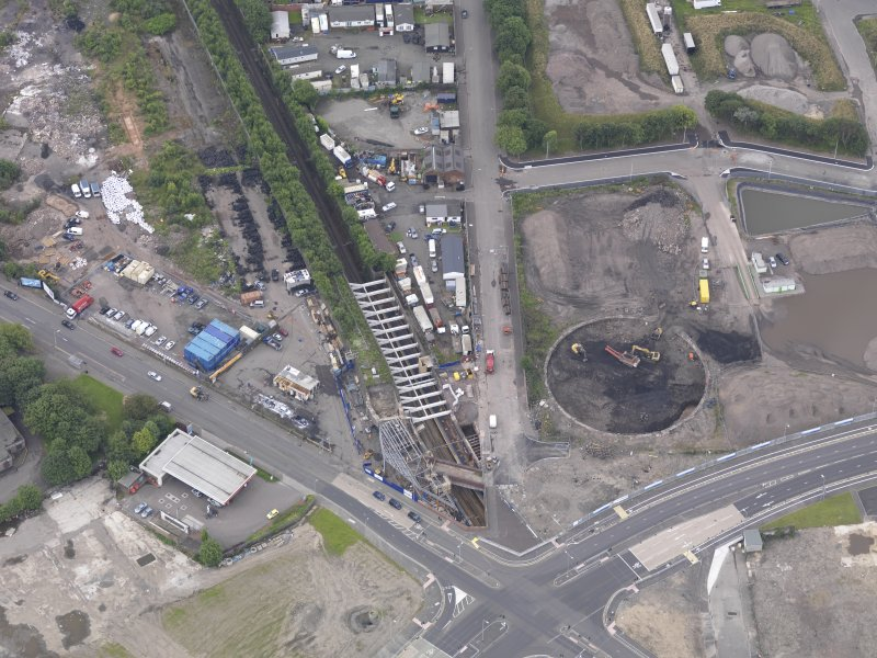 Oblique aerial view of Dalmarnock Station during construction works, taken from the NE.