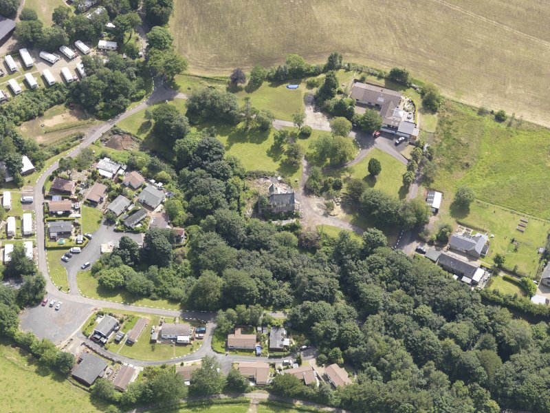 Oblique aerial view of Crosbie Tower House, taken from the NW.