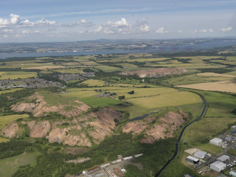 General oblique aerial view of the Winchburgh area centred on Niddry castle, taken from the SW.
