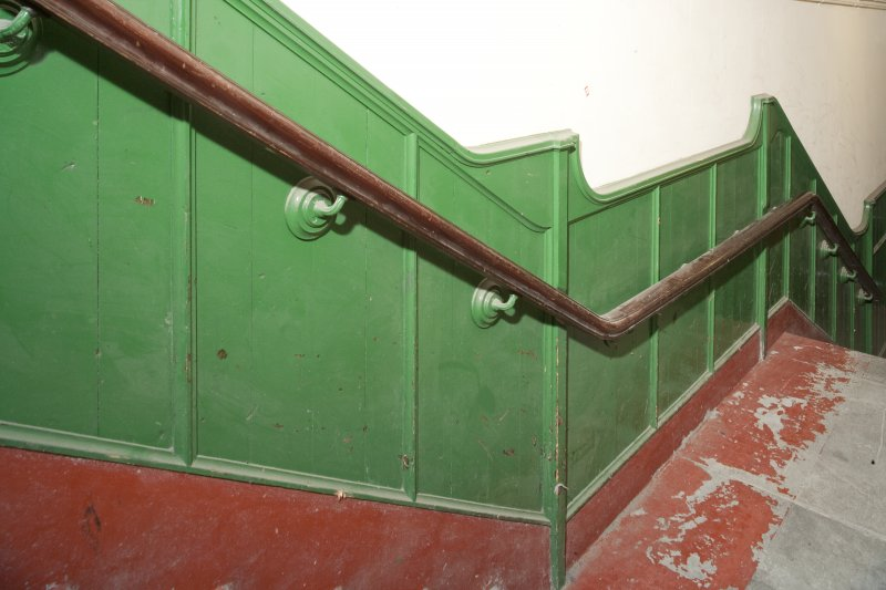 Interior. Detail of bannister and dado rail of side entrance staircase.