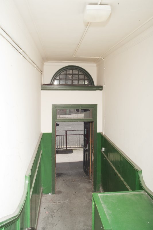 Interior. General view of side entrance staircase to entrance doorway.